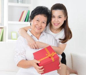 happy grandma and her caregiver
