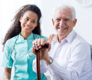 caregiver woman and senior men smiling