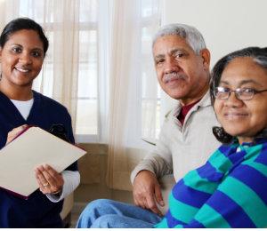 caregiver talking with senior couple